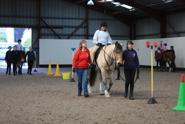 Fergus doing props in riding school