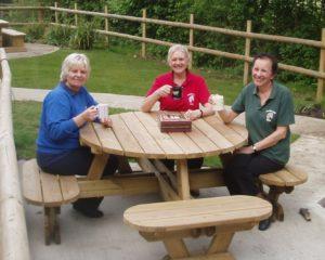 Helpers drinking tea in the garden
