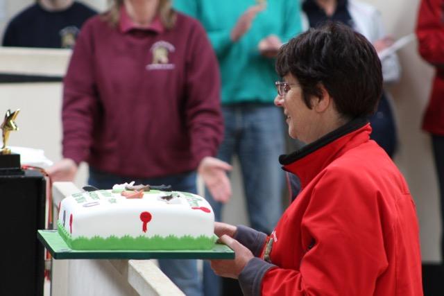 Anne cutting birthday cake