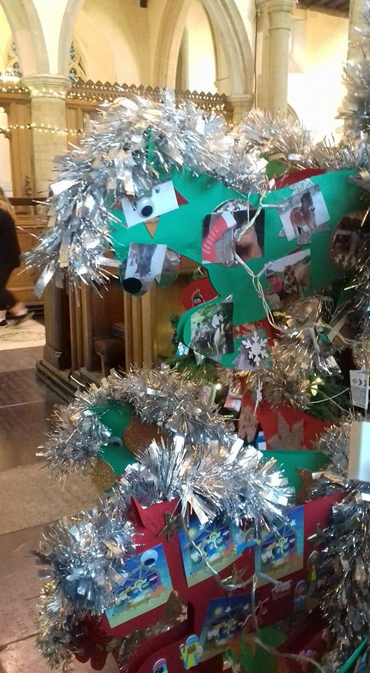 Christmas tree made out of decorated paper horses
