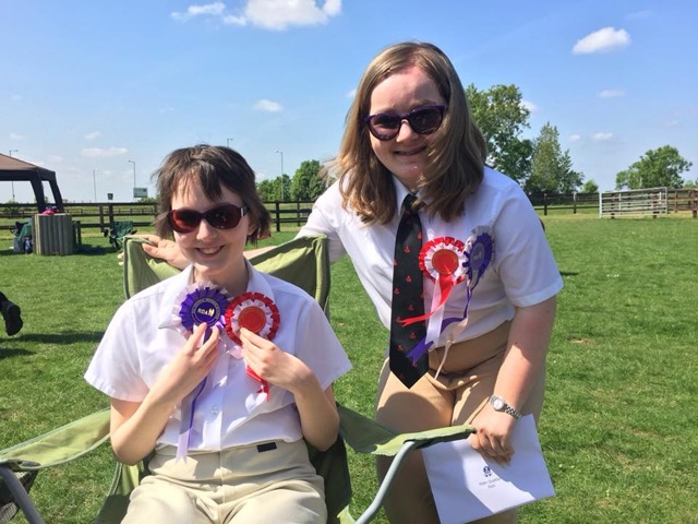 Charlotte and Rebecca with their rosettes