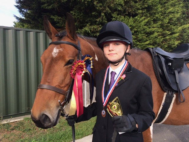 Emma and Jaybee with Emma's rosettes and trophy