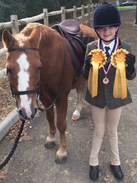 Isabelle got yellow rosettes for third place