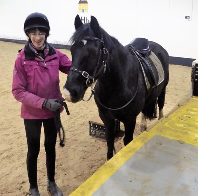 Penny at the mounting block, part of learning to be a riding pony